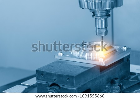The CNC milling machine cutting the aluminium automotive part with the solid ball endmill in the light blue scene .Modern manufacturing process. #1091555660