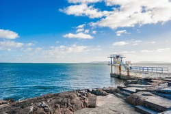 The coast in Salthill overlooking Galway Bay, Ireland, along the Promenade in a sunny bright day