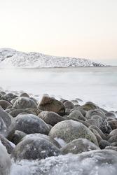The coast of the Arctic Ocean in winter in Teriberka