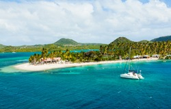 The coast of the island of Martinique in the Caribbean. Yachts, palm trees, beaches and turquoise water. Paradise island of Martinique.