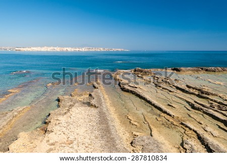 The coastline in the marine protected area of Plemmirio, in Sicily. The city in the background is Syracuse.