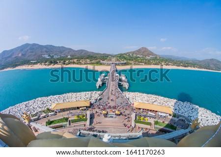 The coastline of Nanshan Buddhist Cultural Park, Sanya, Hainan Island, China. The bridge leads to a Buddha statue.