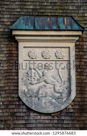 The coat of arms as a decoration on facade of the beautiful traditional German estate in art nouveau (jugendstil) style. Winter in Immenstadt im Allgäu near Alpsee, Bayern.
