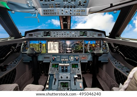 The cockpit of the aircraft with blue sky outside #495046240