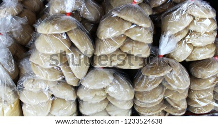 The palm sugar or Jaggery in the market of Thailand Images
