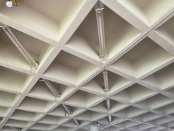 The coffered or waffle ceiling is a unique architectural design of empty spaces between  beams that make up the grids which will create an illusion to make the room looks bigger, and also absorb sound