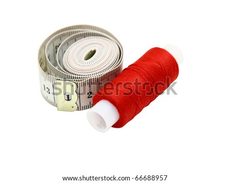 The coil of a red thread with centimeter on a white background - stock photo