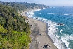 The cold water of the Pacific Ocean washes against the scenic coastline of southern Oregon. This beautiful region of the Pacific Northwest is accessible via highway 101.