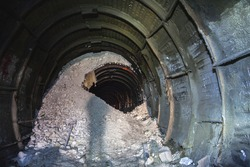 The collapse in the chalk mine, tunnel with metal mine roof supports