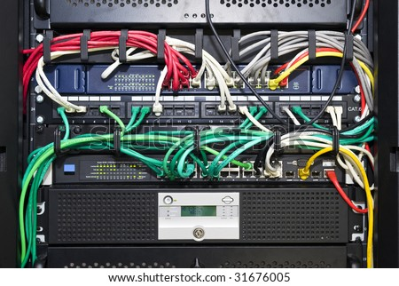 The color coded and neatly bracketed cables for network and telecommunications in an high tech server configuration