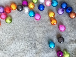 The colored glass beads on the soft gray fabric. The glass beads come in many colors and come as reflectors.