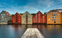 The colorful and iconic old city wharves along the Nidelva river in Trondheim, Trondelag, Norway. Symbol of the historical role of Trondheim as a merchant city.