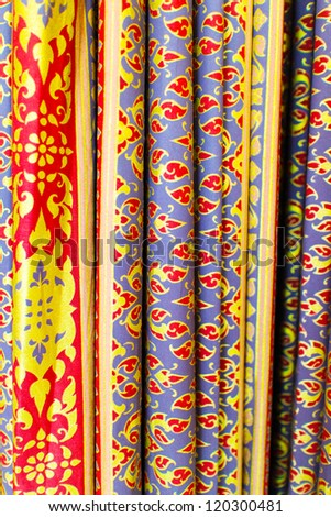 The colorful antique Thai fabric decorated as curtain.