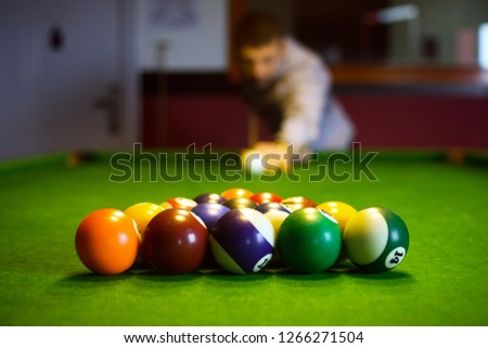The colorful billiard or pool balls for snooker game are on green billiard table for starting the match. #1266271504