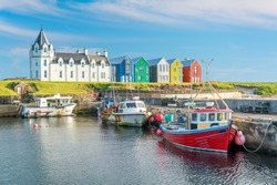 The colorful buildings of John O'Groats in a sunny afternoon, Caithness county, Scotland.