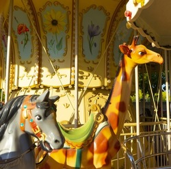 The colorful horse and giraffe on the merry-go-round