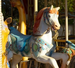 The colorful horse on the merry-go-round