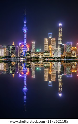 The colorful illuminated urban skyline of Shanghai during night time with reflections in the Huangpu river, China #1172621185