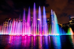 The colorful of fountain on the lake at night, near by Twin Towers; with city on background. Kuala Lumpur, Malaysia.