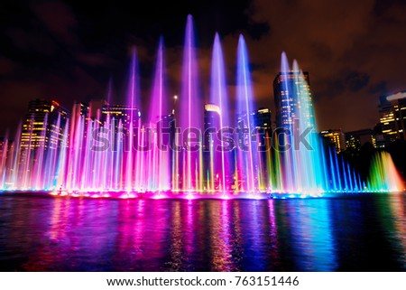 The colorful of fountain on the lake at night, near by Twin Towers; with city on background. Kuala Lumpur, Malaysia. #763151446