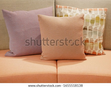 the colorful sofa with cushions