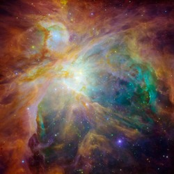 The colorful star-forming region at the heart of nebula M-42 in Orion. Image. Elelments of this image courtesy of NASA and Hubble images.
