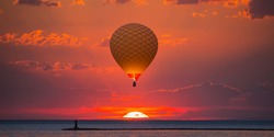 The colorful sunset at the Great Van Lake - Colorful hot air balloon flying over Van lake at red sunset