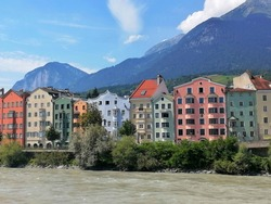 "The colorful town of Innsbruck, Austria is a charming stopover for tourists. The river Inn flows through the city center therefore ""Innsbruck"" literally translates to to the bridge over the Inn."