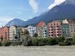"""The colorful town of Innsbruck, Austria is a charming stopover for tourists. The river Inn flows through the city center therefore """"Innsbruck"""" literally translates to to the bridge over the Inn."""