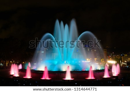 The colorful water show of Magic Fountain of Montjuic with light and music in Barcelona , Spain