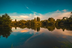 the colorfull trees is reflected in the calm lake in autumn