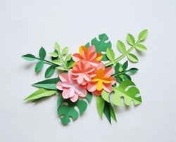 The colors of the paper. White background. Tropics. Paper flowers and leaves. Palma.