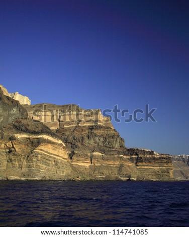 The colossal volcanic cliffs of Santorini Greece