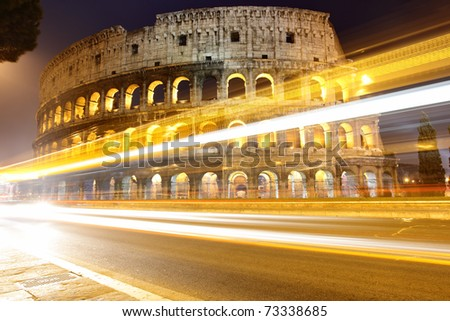 The Colosseum at night and traffic lights