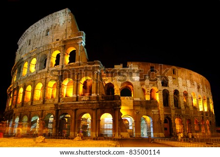 The Colosseum under the glow of lights at night, Rome