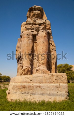 The Colossi of Memnon,  stood in the Theban Necropolis, located west of the River Nile from the modern city of Luxor in Egypt, northern Africa Stock photo ©