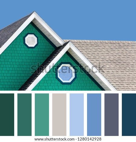 The colour houses of the Magdalen Islands in Canada, with a blue sky background, In a colour palette with complimentary colour swatches.