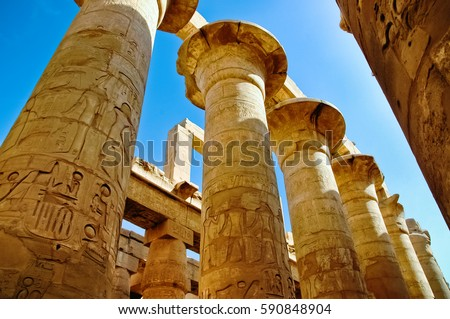 The columns with hieroglyphs in Karnak Temple, Luxor, Egypt
