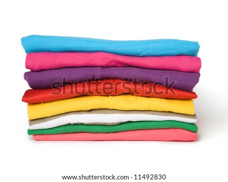 The combined multi-coloured clothes on a white background