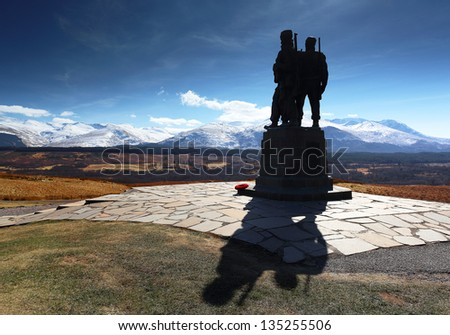 The Commando memorial monument in silhouette with the snow covered Ben Nevis mountain range in the distance. Located 1 mile north of the village Spean bridge near Fort William, Scotland.
