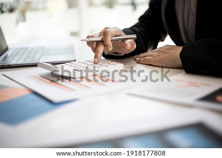 The company's finance manager is using a calculator, he uses a calculator to calculate the numbers in the company's financial documents that employees in the department create as meeting documents.