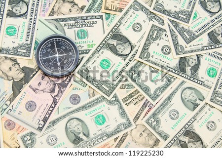 The compass and is a lot of money. Dollars and a compass.
