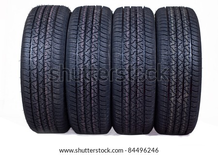 The complete set of new tyres for the car on a white background