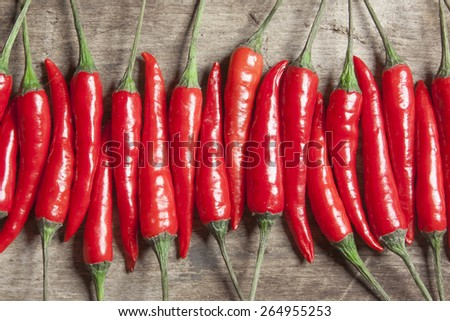 The composition of red hot peppers on a wooden table