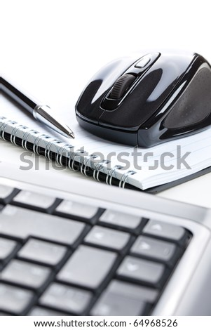 the computer mouse and notebook with pen