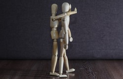 The concept behind the attack. Wooden figures.