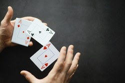 The concept card tricks and presentations. The concept of a sharpie in games. Flying cards in the air. A magician raises cards with the power of thought.