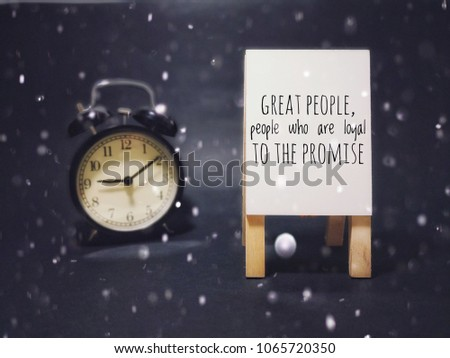 """The concept of a blackboard and a bell clock with words of enthusiasm """"Great people, people loyal to the promise"""" #1065720350"""