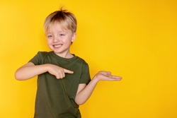 The concept of a good mood. Positive vibes. Totally satisfied with Shopping Day. I feel cool. Cute boy 5-6 years old on a yellow background.