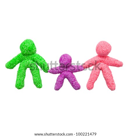 The concept of a happy family, made of colorful foam clay. Three figures, symbolizing the mother, father and baby, holding hands.